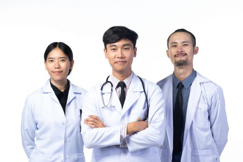 Portrait of an Asian doctor on white background